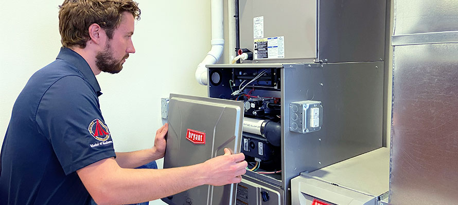 affordable heating technician installing a bryant furnace